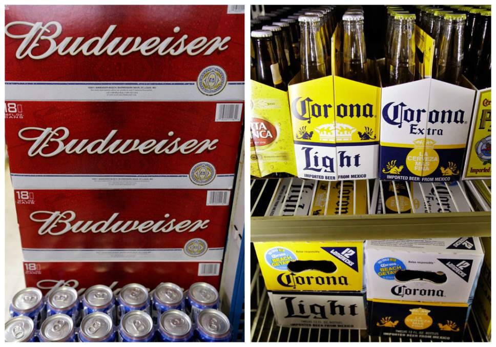 FILE - This combination of Associated Press undated file photos shows Budweiser beer in the aisles of Elite Beverages in Indianapolis, and Constellation Brands Corona beers displayed at a liquor store in Palo Alto, Calif.  (AP Photos/File)