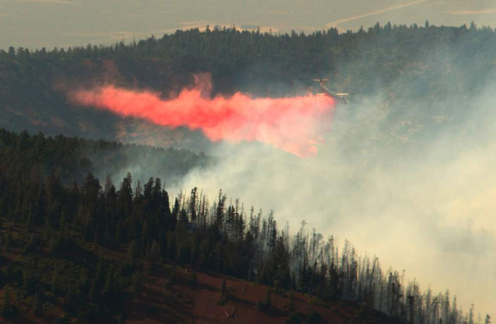 Rick Egan  |  The Salt Lake Tribune  A plane drop fire retardant on the Brian Head fire, as it continues to burn north of the southern Utah ski town of Brian Head, Wednesday, June 21, 2017.