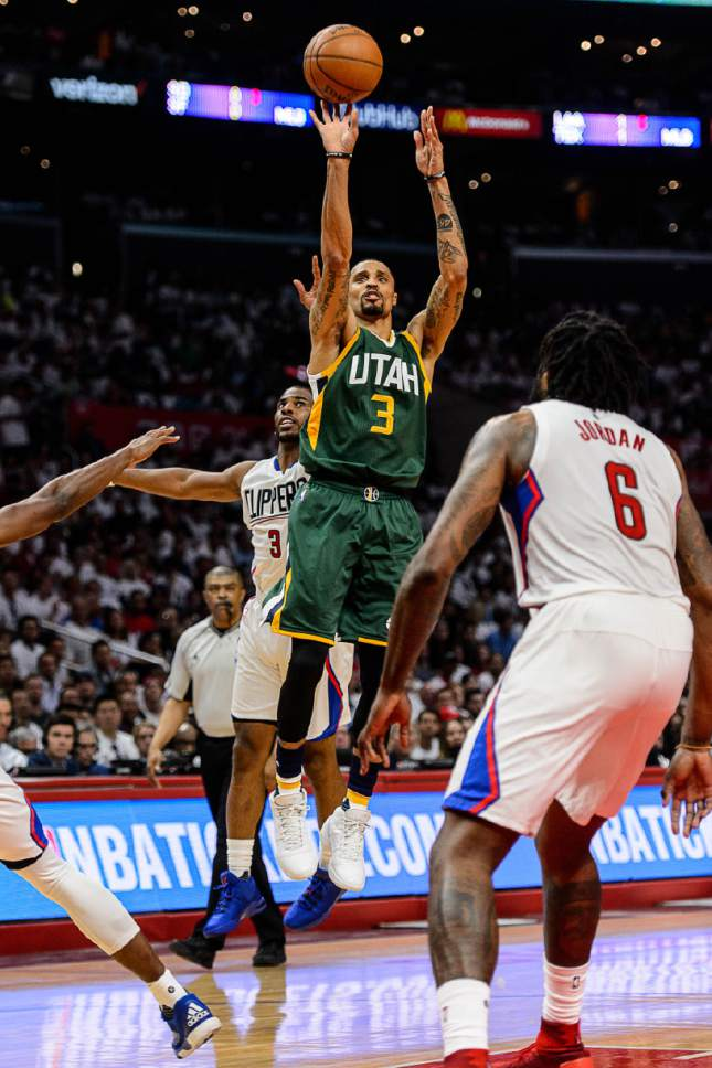 Trent Nelson  |  The Salt Lake Tribune Utah Jazz guard George Hill (3) puts up a shot ahead of LA Clippers guard Chris Paul (3) as the Utah Jazz face the Los Angeles Clippers in Game 7 at STAPLES Center in Los Angeles, California, Sunday April 30, 2017.