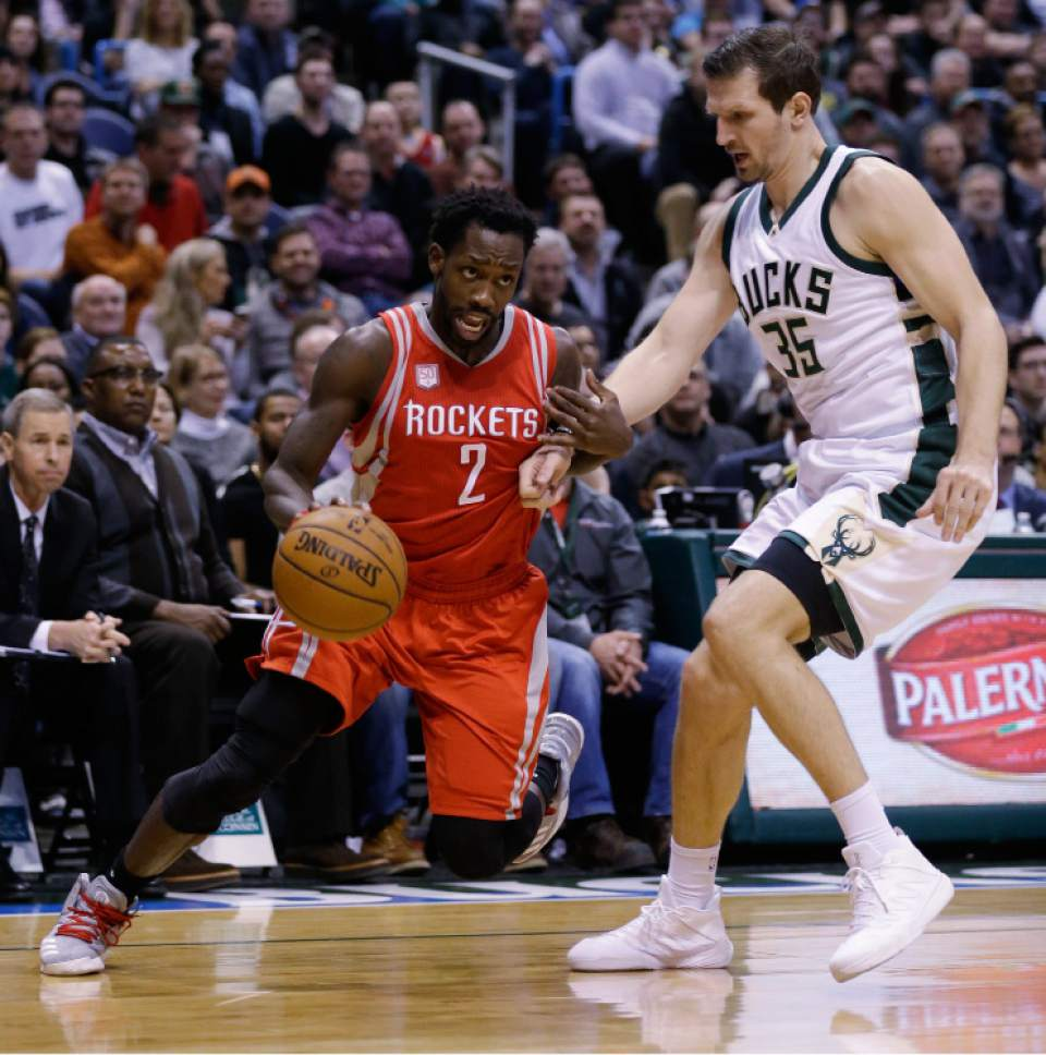 Houston Rockets' Patrick Beverley (2) drives against the Milwaukee Bucks' Mirza Teletovic during the first half of an NBA basketball game, Monday, Jan. 23, 2017, in Milwaukee. (AP Photo/Jeffrey Phelps)