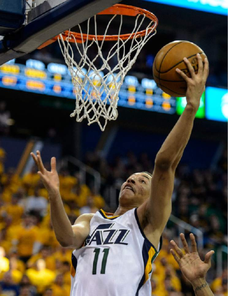 Steve Griffin  |  The Salt Lake Tribune   Utah Jazz guard Dante Exum (11) gets to the basket during game 4 of the NBA playoff game between the Utah Jazz and the Golden State Warriors at Vivint Smart Home Arena in Salt Lake City Monday May 8, 2017.