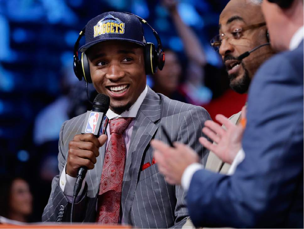Donovan Mitchell answers questions during an interview after being selected by the Denver Nuggets as the 13th pick overall during the NBA basketball draft, Thursday, June 22, 2017, in New York. (AP Photo/Frank Franklin II)