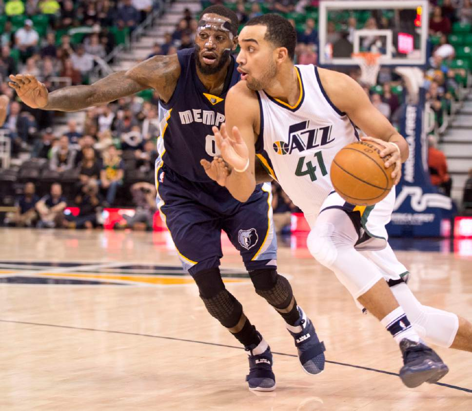 Lennie Mahler  |  The Salt Lake Tribune  Trey Lyles drives past JaMychal Green in a game against the Memphis Grizzlies on Saturday, Jan. 28, 2017, at Vivint Smart Home Arena in Salt Lake City.