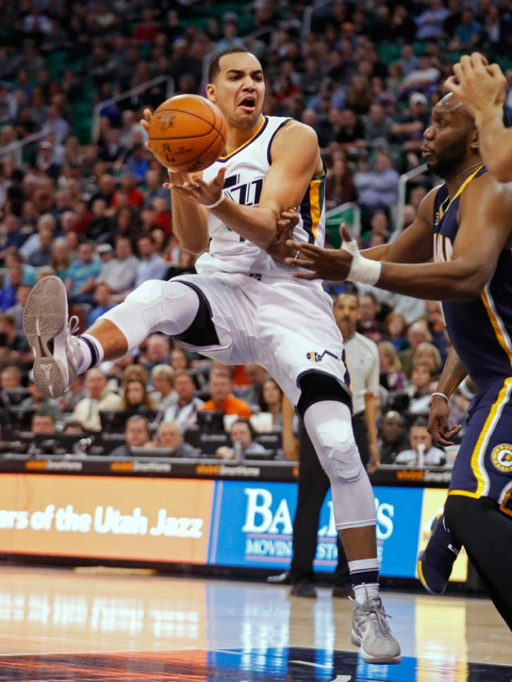 Utah Jazz forward Trey Lyles, left, is fouled by Indiana Pacers center Al Jefferson, right, during the second half of an NBA basketball game, Saturday, Jan. 21, 2017, in Salt Lake City. The Jazz defeated the Pacers 109-100. (AP Photo/George Frey)