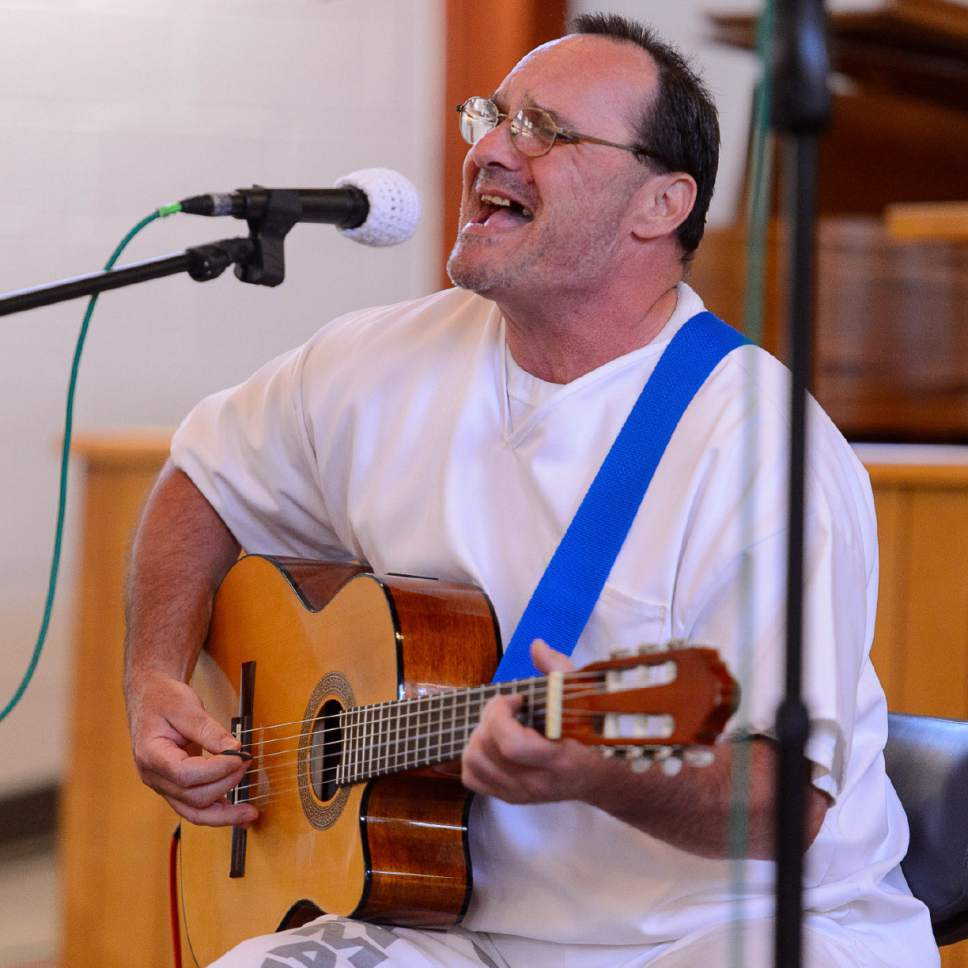"Trent Nelson  |  The Salt Lake Tribune Thomas Justet sings ""Runnin' on Faith"" as inmates at the Utah State Prison put on their Spring Recital, Saturday June 24, 2017, as part of the Wasatch Music Education Program."