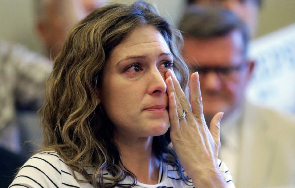 Rick Bowmer  |  AP Photo   Desiree Hennessy cries during the Utah Patients Coalition news conference at the Utah State Capitol Monday, June 26, 2017, in Salt Lake City. A group of activists and Utah residents with chronic conditions has launched a ballot initiative to ask voters next year to pass a broad medical marijuana law. Her adopted son Hestevan has Cerebral Palsy and suffers from chronic nerve pain, seizure disorder, and life threatening complications from his medication.