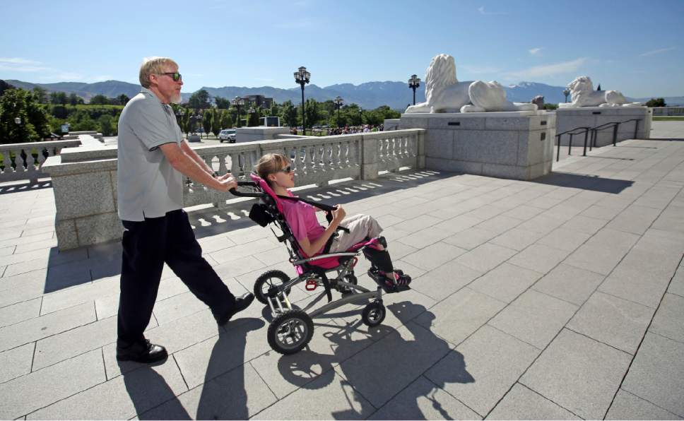 Rick Bowmer  |  AP Photo   Doug Rice and his daughter Ashley arrive at the Utah Capitol for a Utah Patients Coalition news conference Monday, June 26, 2017, in Salt Lake City. A group of activists and Utah residents with chronic conditions has launched a ballot initiative to ask voters next year to pass a broad medical marijuana law.