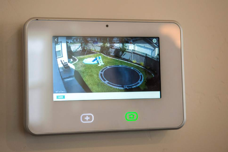 Chris Detrick  |  The Salt Lake Tribune James and Aleisha McDaniel's demonstrate the backyard camera on the SkyControl Panel in their Vivint Smart Home in South Jordan Thursday, June 8, 2017.