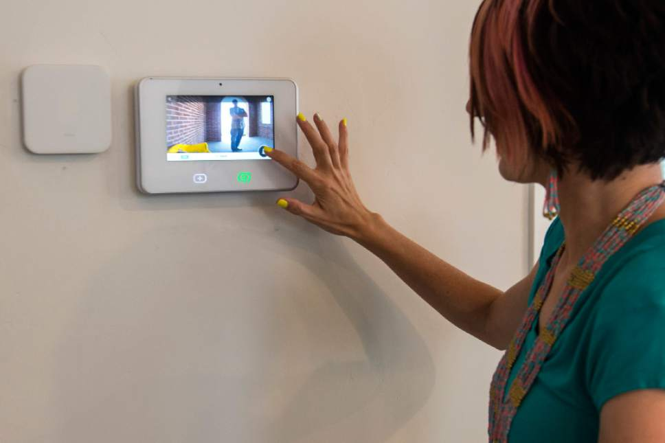 Chris Detrick  |  The Salt Lake Tribune James and Aleisha McDaniel's demonstrate the doorbell camera on the SkyControl Panel in their Vivint Smart Home in South Jordan Thursday, June 8, 2017.