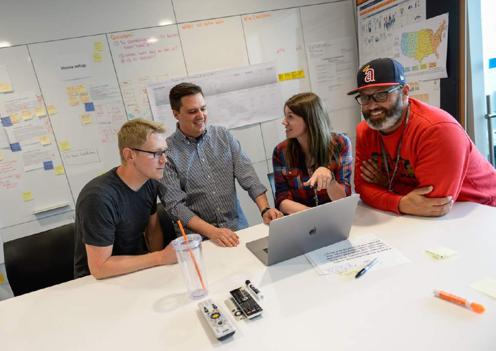 Francisco Kjolseth | The Salt Lake Tribune Wes Hotchlass, UX Designer, Gavin Jensen, Design Manager, Janelle Seegmiller, Dir. of Product Hardware and Clint Gordon-Carroll, VP of Cloud Storage, from left, collaborate on a project at the Vivint Innovations Center in Lehi recently.