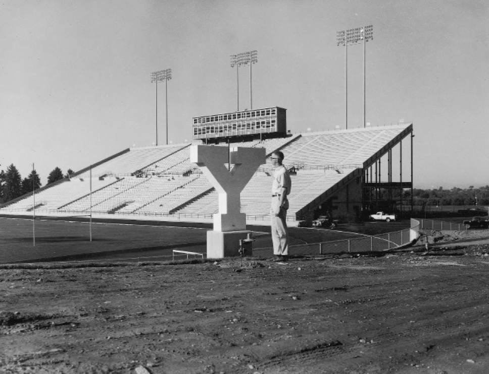 |  Courtesy  A worker installing the Y at a finished Cougar Stadium in 1964.