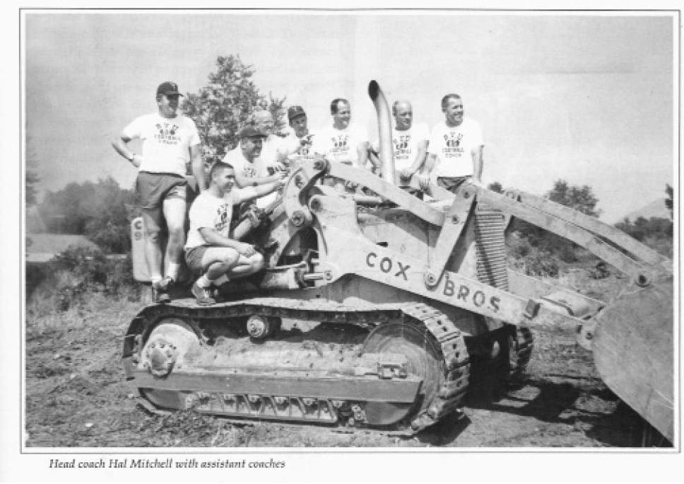 |  Courtesy  Bulldozer with BYU's Head football coach, Hal Mitchell, and his staff in 1964.