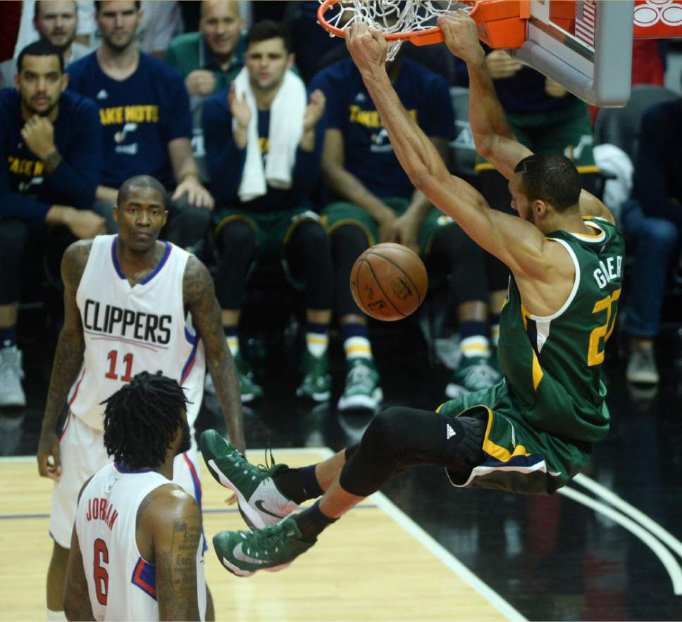 Steve Griffin  |  The Salt Lake Tribune   Utah Jazz center Rudy Gobert (27) throws down a dunk during game 5 of the the Jazz versus Clippers NBA playoff game at the Staples Center in Los Angeles Tuesday April 25, 2017.