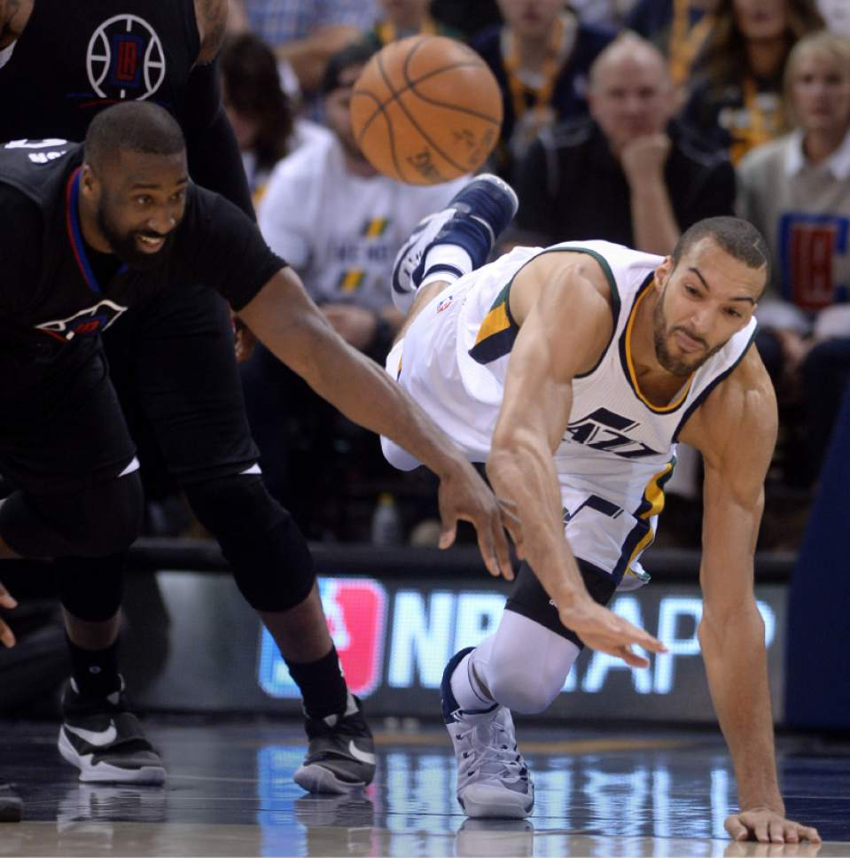 Steve Griffin  |  The Salt Lake Tribune   Utah Jazz center Rudy Gobert (27) dives for the ball during the Jazz versus Clippers NBA playoff game at Viviint Smart Home arena in Salt Lake City Sunday April 23, 2017.