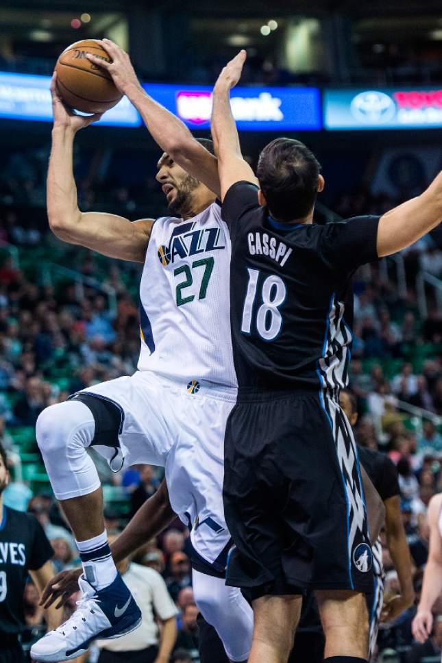 Chris Detrick  |  The Salt Lake Tribune Utah Jazz center Rudy Gobert (27) shoots past Minnesota Timberwolves forward Omri Casspi (18) during the game at Vivint Smart Home Arena Friday, April 7, 2017.