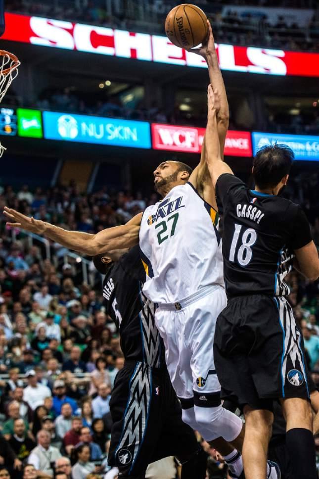 Chris Detrick  |  The Salt Lake Tribune Minnesota Timberwolves forward Omri Casspi (18) fouls Utah Jazz center Rudy Gobert (27) during the game at Vivint Smart Home Arena Friday, April 7, 2017.