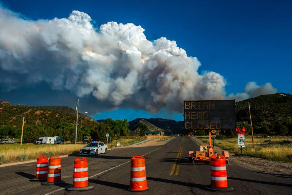 Chris Detrick  |  The Salt Lake Tribune Smoke rises from the wildfire burning north of the southern Utah ski town of Brian Head as seen from Parowan Tuesday, June 20, 2017. The Brian Head Fire -- which forced the evacuation of about 750 residents and visitors on Saturday -- was started by someone using a weed torch in dry conditions, Gov. Gary Herbert tweeted Tuesday, ahead of a 1 p.m. news conference.