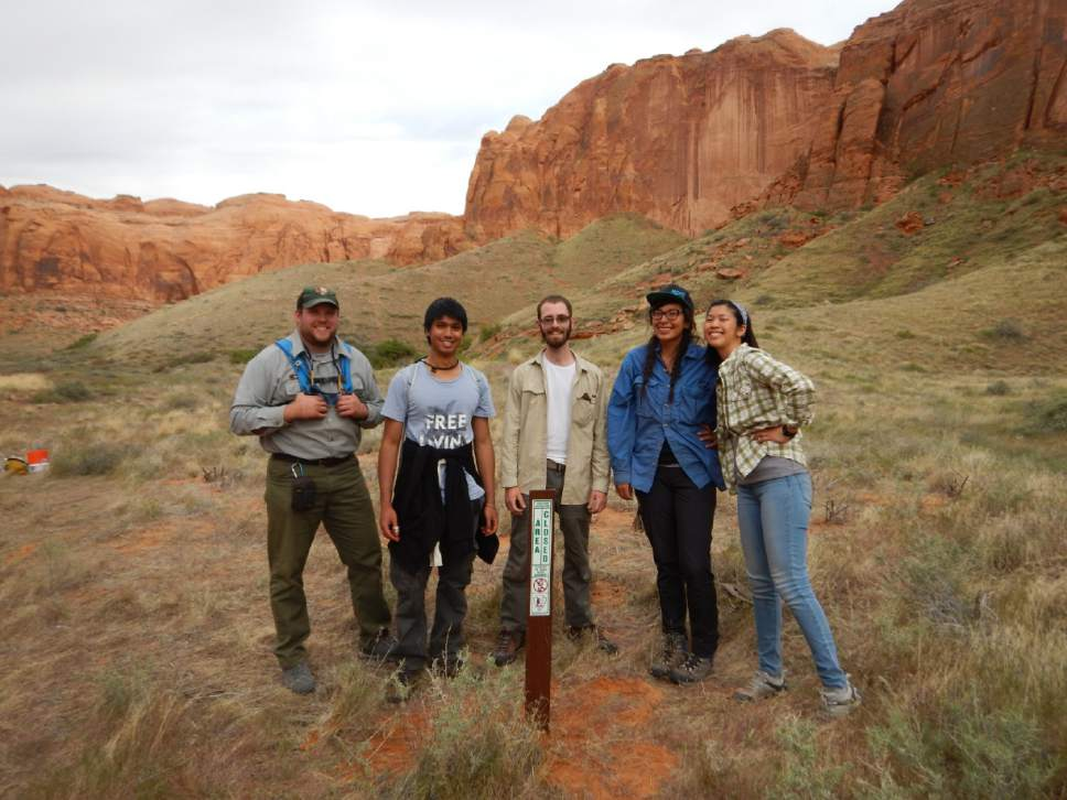 Ka-Voka Jackson, second from right, poses with her research team at Glen Canyon National Recreation Area, where they are trying to rehabilitate canyons infested with ravenna grass. Courtesy Ka-Voka Jackson