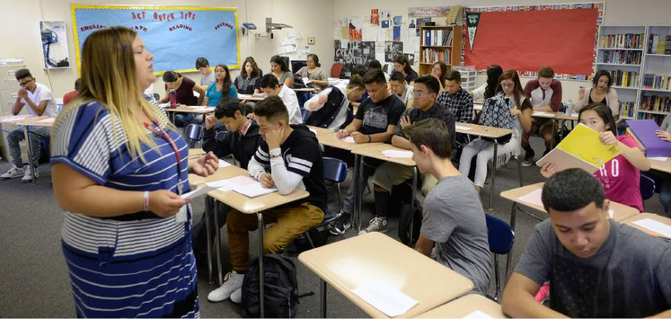 Al Hartmann  |   Tribune file photo Teacher Brook Taylor gives her new students their first writing assignment for ACT Prep class Monday August 22 at Granger High School.