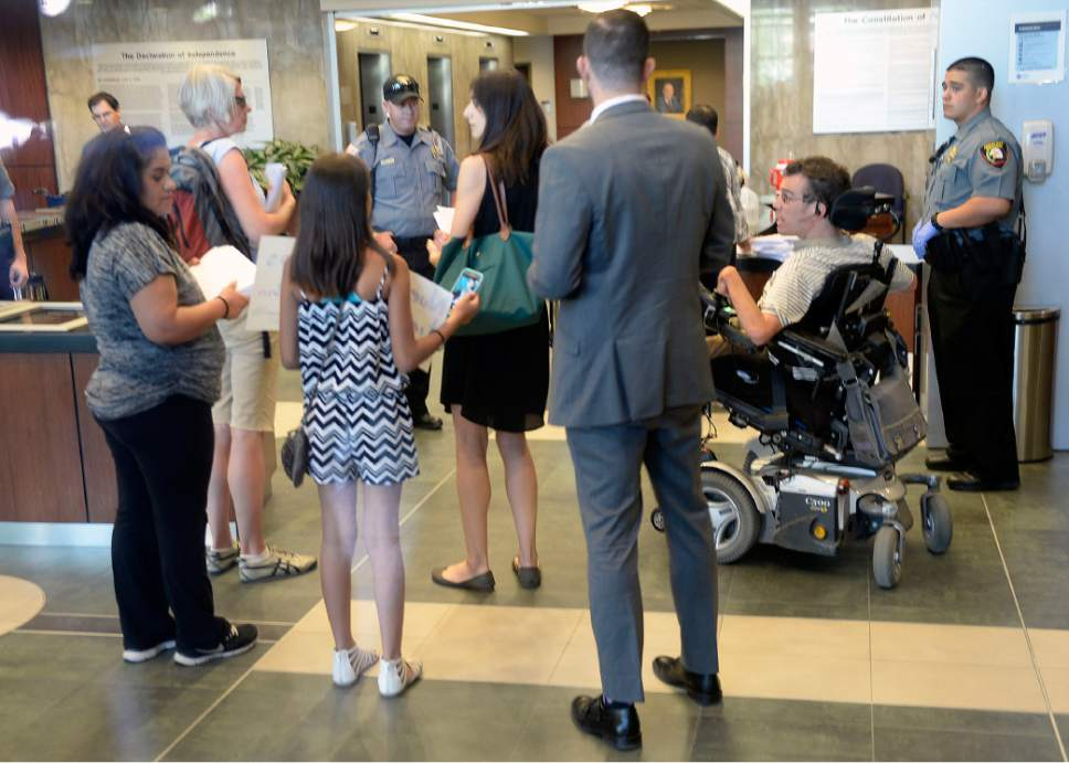 Al Hartmann  |  The Salt LakeTribune Advocates and community members wait in the lobby of the the Wallace F. Bennett Federal Building on Wednesday, June 28, to hand off a petition urging Sens. Orrin Hatch and Mike Lee to keep Medicaid intact.