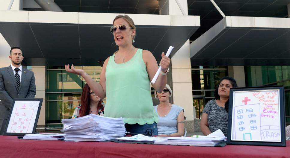 Al Hartmann  |  The Salt LakeTribune Joanna Smith with Utah Women Unite speaks in front of the Wallace F. Bennett Federal Building on Wednesday, June 28, to explain why keeping her health care insurance is so important in helping her son with autism.