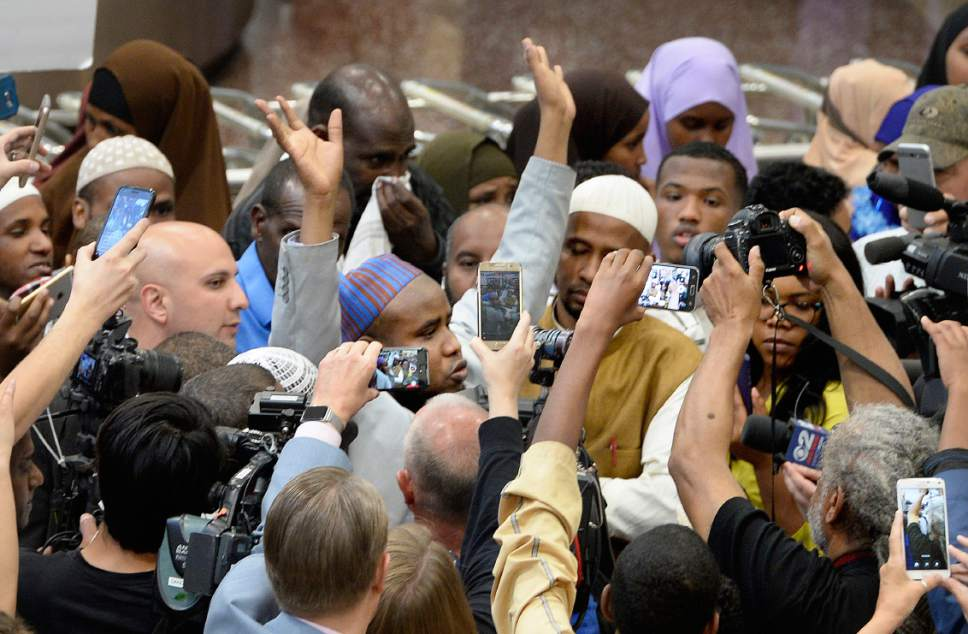 Scott Sommerdorf | The Salt Lake Tribune Imam Yussuf Awadir Abdi spoke about his travel issues while he was surrounded in a sea of friends, family, and media after he arrived at Salt Lake City International airport, Sunday, June 18, 2017.