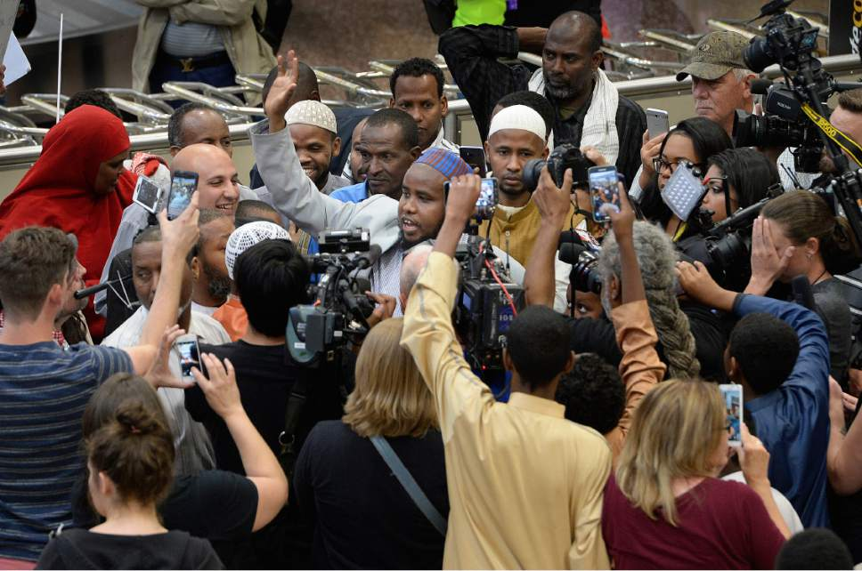 Scott Sommerdorf | The Salt Lake Tribune Imam Yussuf Awadir Abdi is surrounded in a sea of friends, family, and media after he arrived at Salt Lake City International airport, Sunday, June 18, 2017.