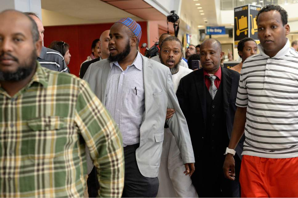 Scott Sommerdorf | The Salt Lake Tribune Imam Yussuf Awadir Abdi sets off with friends and family to the lost luggage counter to find his luggage after he arrived at Salt Lake City International airport, Sunday, June 18, 2017.