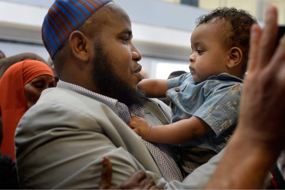 Scott Sommerdorf | The Salt Lake Tribune Imam Yussuf Awadir Abdi looks his nephew in the eyes  after he arrived at Salt Lake City International airport, Sunday, June 18, 2017.