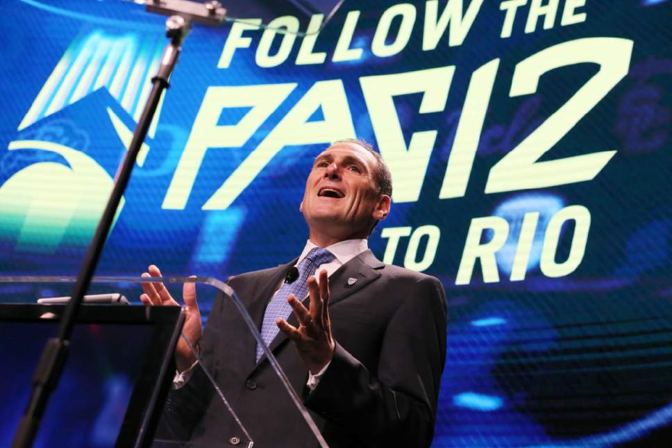 ADVANCE FOR SATURDAY, OCT. 1 - In this July 14, 2016, file photo, Pac-12 commissioner Larry Scott speaks at the Pac-12 NCAA college football media day in Los Angeles. Scott helped transform and modernize the Pac-12 when he took over as commissioner, helped the conference land a $3 billion TV deal and create its own network. Eight years later, the conference is reaping financial rewards and he believes it is well-positioned to adapt to the changing landscape of both college sports and media rights. (AP Photo/Reed Saxon, File)