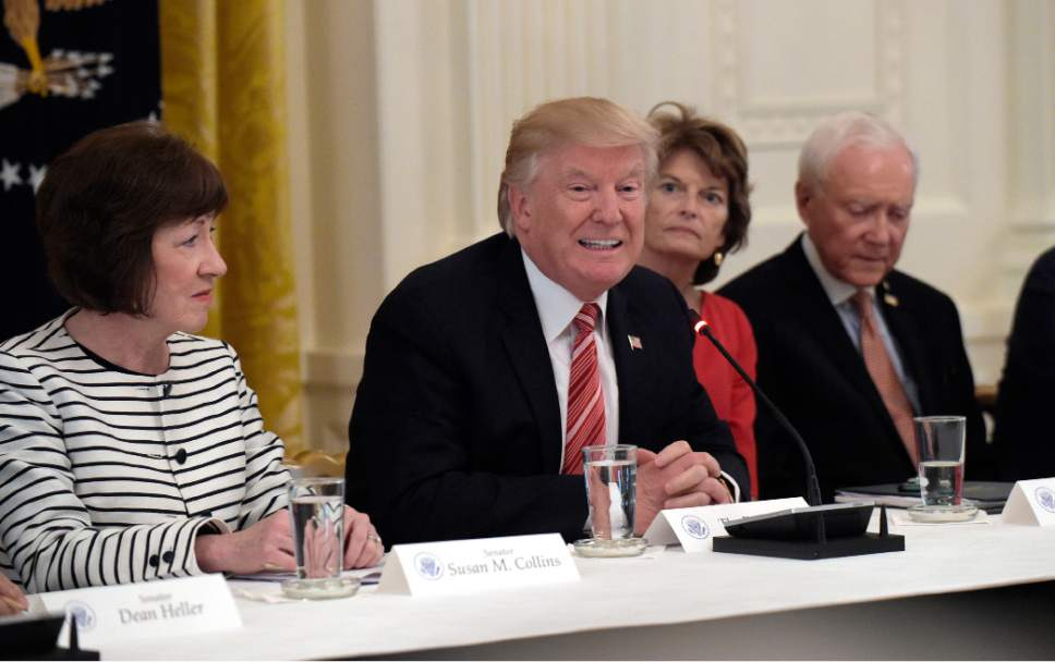 President Donald Trump, center, speaks as he meets with Republican senators on health care in the East Room at the White House in Washington, Tuesday, June 27, 2017. Seated with him, from left, are Sen. Susan Collins, R-Maine, Sen. Lisa Murkowski, R-Alaska, and Sen. Orrin Hatch, R-Utah. (AP Photo/Susan Walsh)