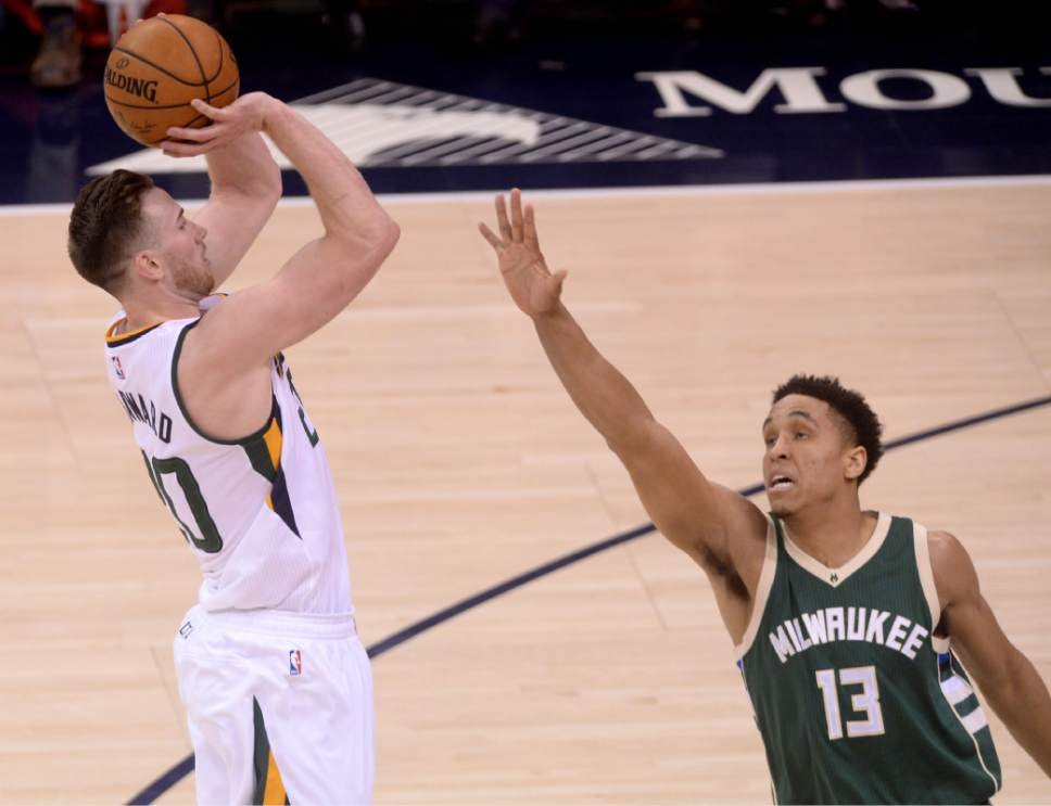 Steve Griffin / The Salt Lake Tribune  Utah Jazz forward Gordon Hayward (20) shoots over Milwaukee Bucks guard Malcolm Brogdon (13) during NBA game at Vivint Smart Home Arena in Salt Lake City Wednesday February 1, 2017.