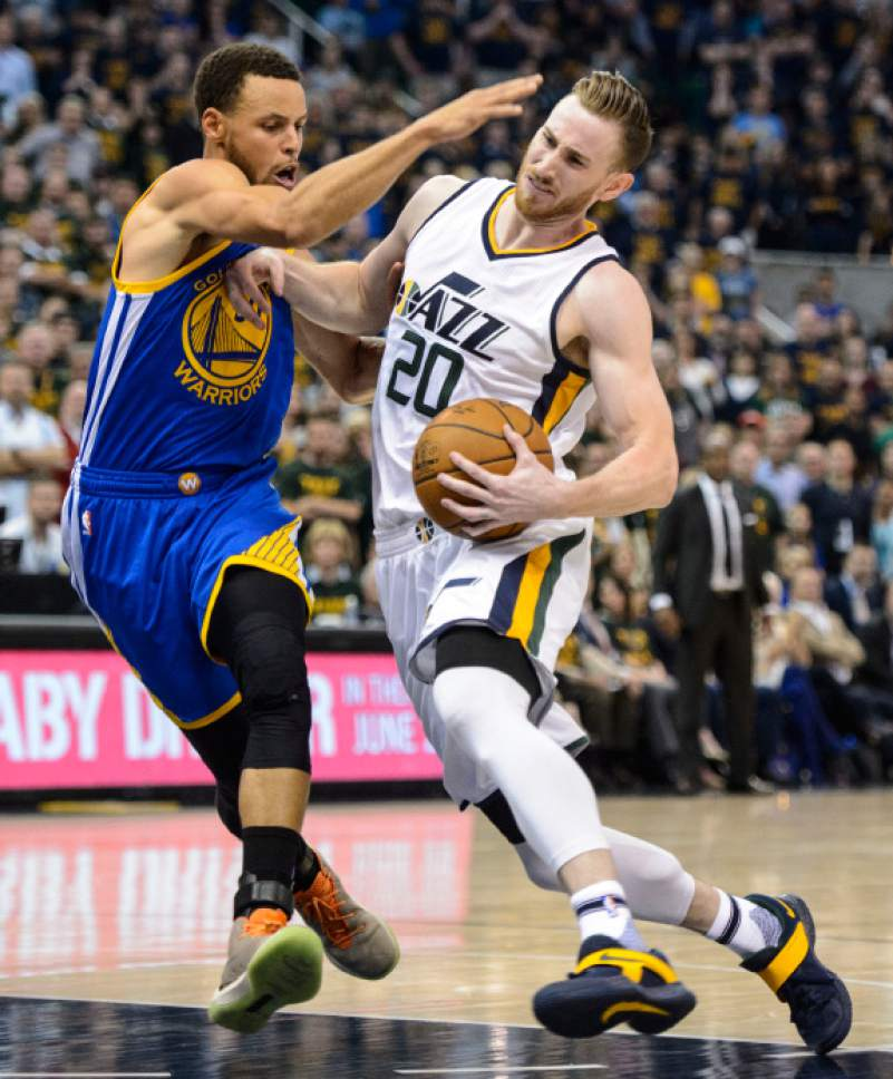 Steve Griffin  |  The Salt Lake Tribune   Utah Jazz forward Gordon Hayward (20) powers his way past Golden State Warriors guard Stephen Curry (30) during game 4 of the NBA playoff game between the Utah Jazz and the Golden State Warriors at Vivint Smart Home Arena in Salt Lake City Monday May 8, 2017.