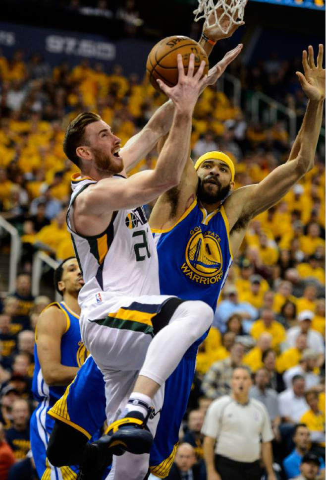 Steve Griffin  |  The Salt Lake Tribune   Utah Jazz forward Gordon Hayward (20) gets to the basket as Golden State Warriors center JaVale McGee (1) defends during game 4 of the NBA playoff game between the Utah Jazz and the Golden State Warriors at Vivint Smart Home Arena in Salt Lake City Monday May 8, 2017.