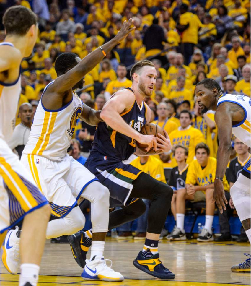 Steve Griffin  |  The Salt Lake Tribune   Utah Jazz forward Gordon Hayward (20) drives between Golden State Warriors forward Draymond Green (23) and Golden State Warriors forward Kevin Durant (35) during game 2 of the NBA playoff game between the Utah Jazz and the Golden State Warriors at Oracle Arena in Oakland Thursday May 4, 2017.