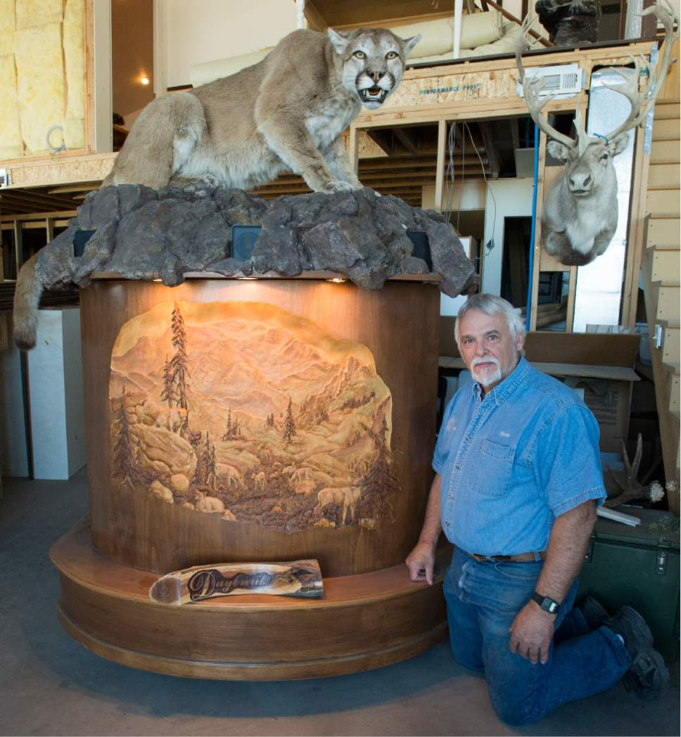 Rick Egan  |  The Salt Lake Tribune  Sculpture Steve Bartholomew specializes in wood-carved taxidermy stands. June 14, 2017.