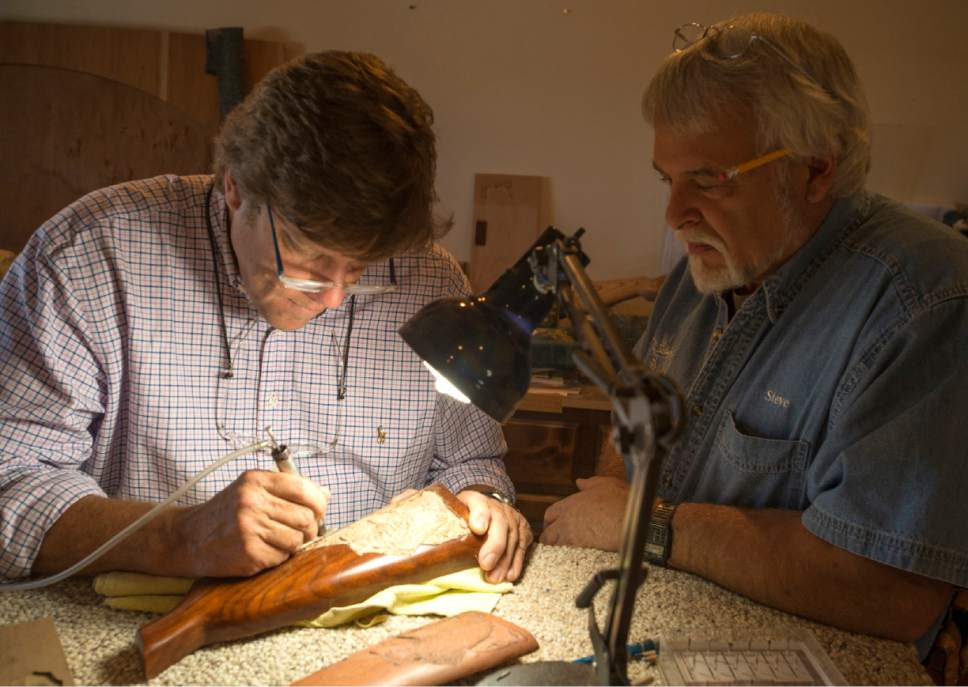 Rick Egan  |  The Salt Lake Tribune  Jerry Hale carves a gun stock as sculptor Steve Bartholomew assists, in Bartholomew's cabinet store in Cedar City. June 14, 2017.