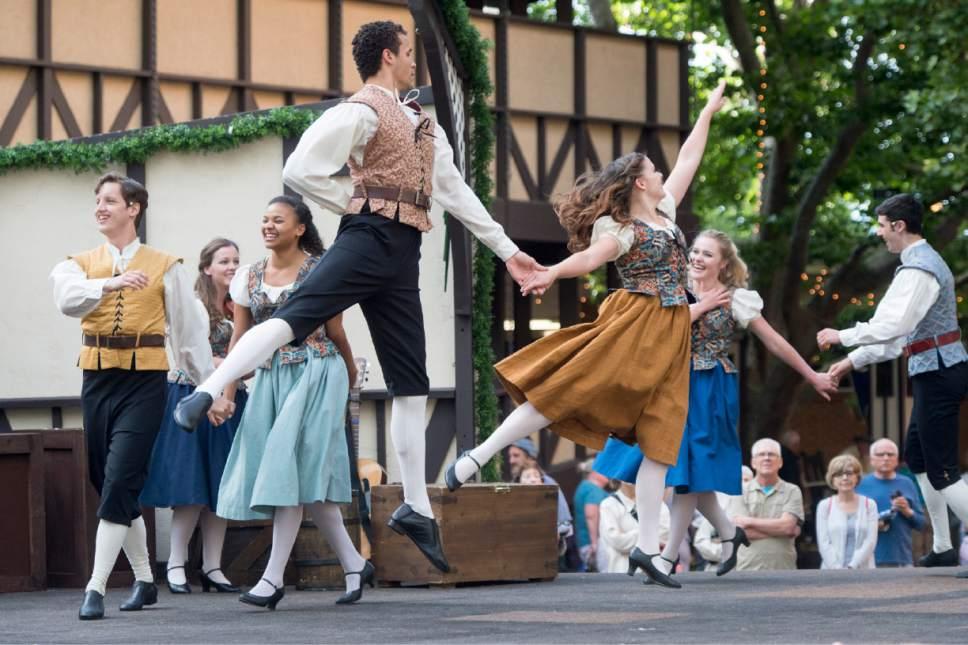 Rick Egan     The Salt Lake Tribune  The Green Show actors entertain the crowd, at Utah Shakespeare Festival. Wednesday, July 8, 2015.