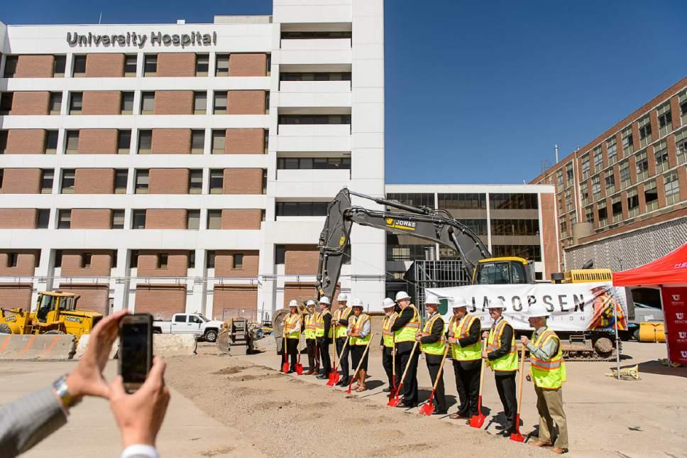 Trent Nelson  |  The Salt Lake Tribune   Ground is ceremoniously broken for the University of Utah's new Ambulatory Care Center in Salt Lake City on Friday, June 30, 2017.
