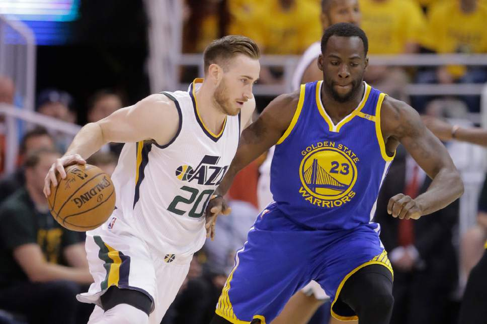 Utah Jazz forward Gordon Hayward (20) drives as Golden State Warriors forward Draymond Green (23) defends in the first half during Game 4 of the NBA basketball second-round playoff series, Monday, May 8, 2017, in Salt Lake City. (AP Photo/Rick Bowmer)