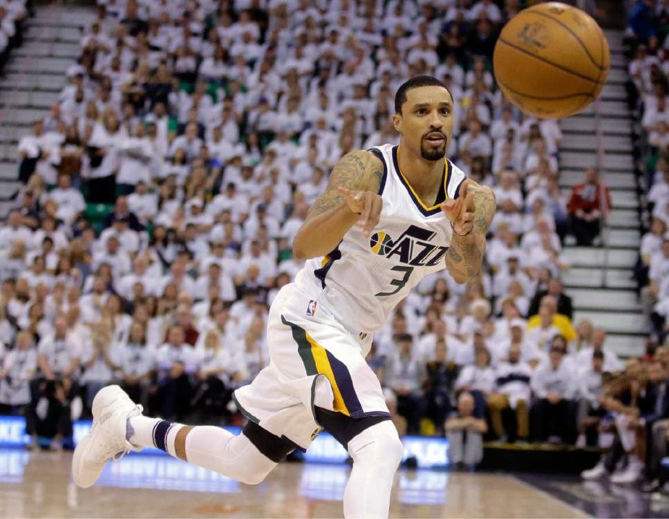 FILE - In this April 28, 2017, file photo, Utah Jazz guard George Hill (3) passes the ball during the second half in Game 6 of an NBA basketball first-round playoff series in Salt Lake City. Hill will not play against the Golden State Warriors in Game 2 on Thursday, May 4, 2017,  due to left big toe soreness. The injury has lingered throughout the season and kept the ninth-year veteran from 16 regular-season games. Hill has averaged 15.6 points, 3.6 assists and 4.1 rebounds in the playoffs. (AP Photo/Rick Bowmer, File)