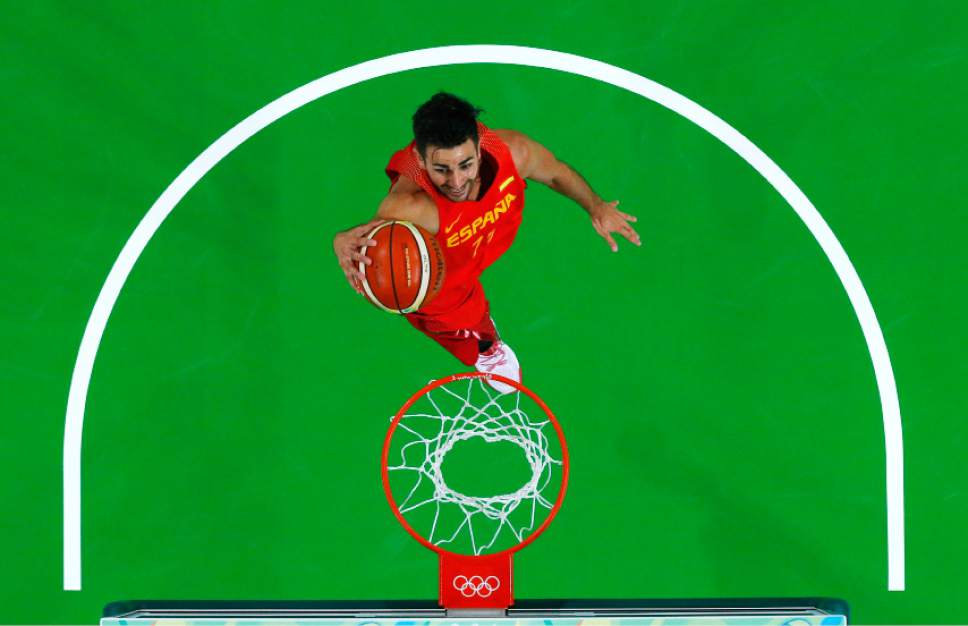 FILE - In this Aug. 11, 2016, file photo, Spain's Ricky Rubio drives to the basket during a basketball game against Nigeria at the 2016 Summer Olympics in Rio de Janeiro, Brazil. When Rubio lost his mother to cancer this summer, there were times he wondered if he had any basketball left in him. He tells The Associated Press that he thought about pulling out of the Rio Games to be with his family. But he chose to stay, and he has been a catalyst for Spain heading into a semifinal showdown with the United States on Friday, Aug. 19. (Jim Young/Pool Photo via AP, File)
