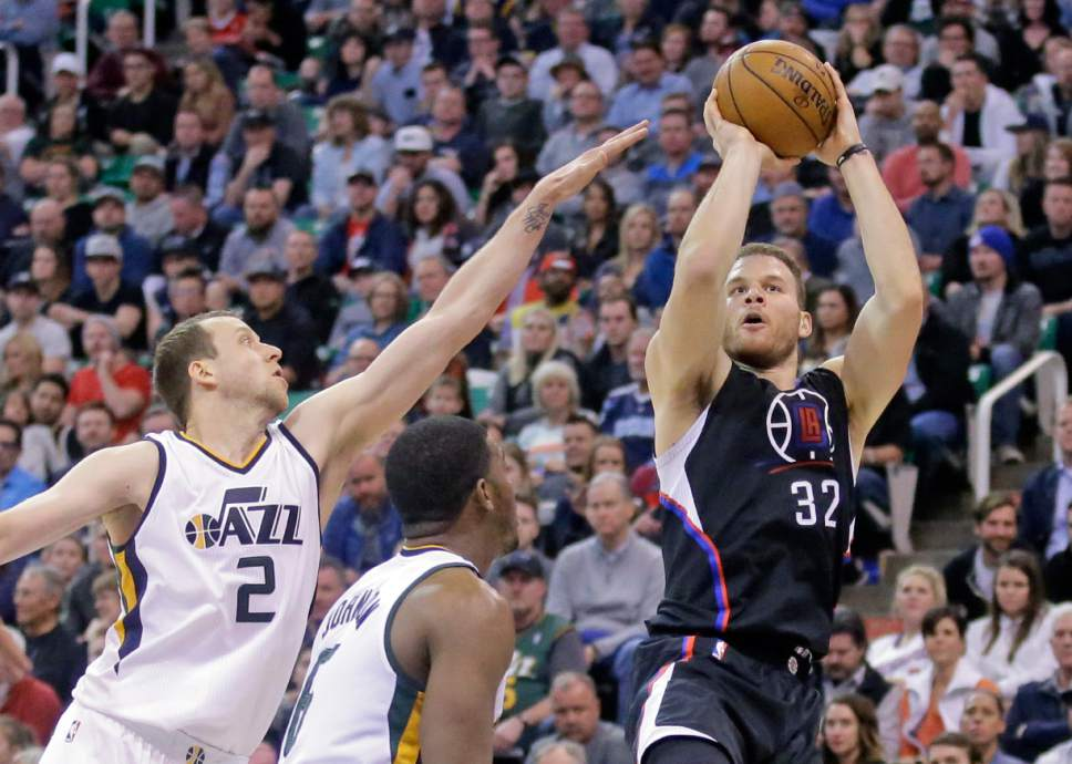 LA Clippers forward Blake Griffin (32) shoots as Utah Jazz forward Joe Ingles (2) defends in the first half during an NBA basketball game Monday, Feb. 13, 2017, in Salt Lake City. (AP Photo/Rick Bowmer)