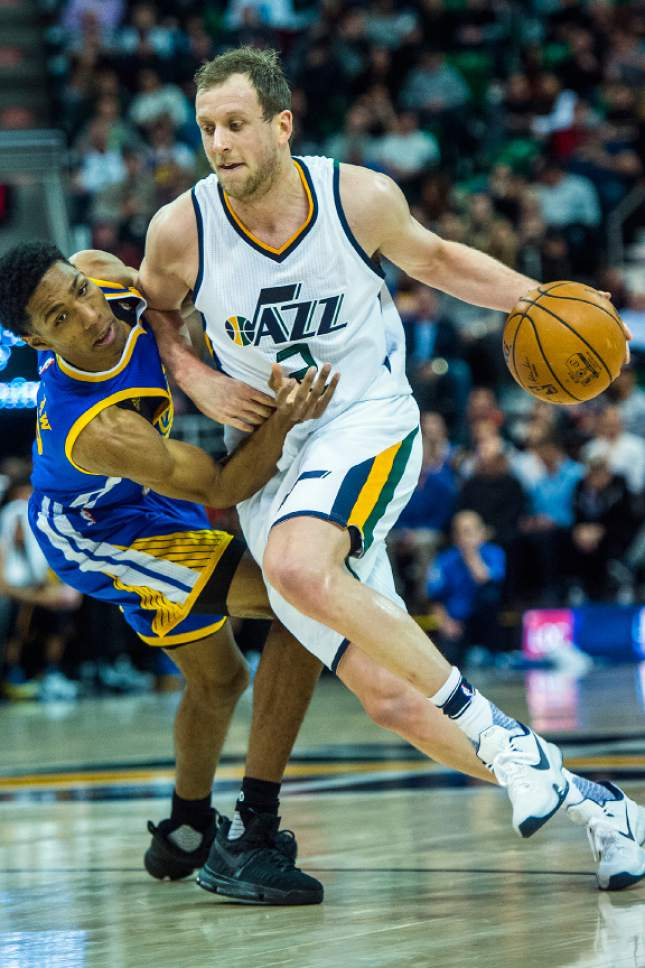 Chris Detrick  |  The Salt Lake Tribune Golden State Warriors guard Patrick McCaw (0) guards Utah Jazz forward Joe Ingles (2) during the game at Vivint Smart Home Arena Thursday December 8, 2016.