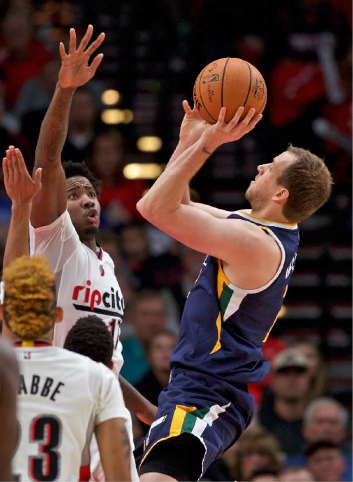 Utah Jazz forward Joe Ingles, right, shoots over Portland Trail Blazers forward Ed Davis, left, during the first half of an NBA basketball game in Portland, Ore., Tuesday, Oct. 25, 2016. (AP Photo/Craig Mitchelldyer)