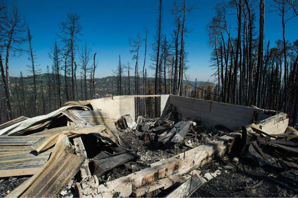 Rick Egan  |  The Salt Lake Tribune  The remains of the cabin that burned to the ground last week, at Brian Head ski resort Friday, June 30, 2017.