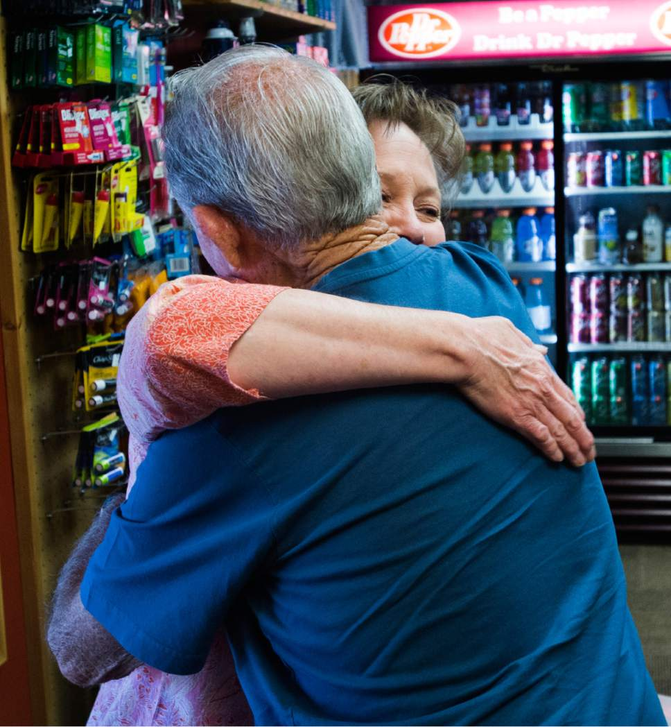 Rick Egan  |  The Salt Lake Tribune Ray Kaminsky hugs Shelly Calloway as Shelly prepares Apple Annies Country Store for business now that the evacuation of the southern Utah ski town of Brian Head has been lifted on Friday, June 30, 2017.