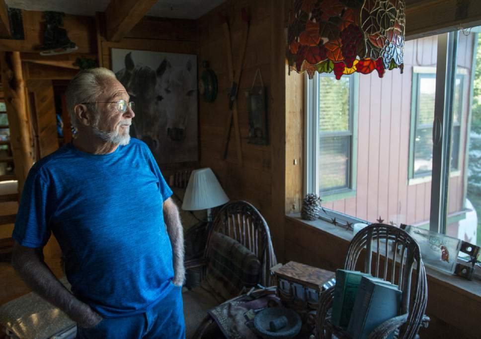 Rick Egan  |  The Salt Lake Tribune   Gary Sylvester gazes out the window of his cabin on Friday, June 30, 2017, as he recounts the tall flames he saw coming over the ridge the day the fire started in the southern Utah ski town of Brian Head. Residents are able to return to their homes today after two weeks of being evacuated.