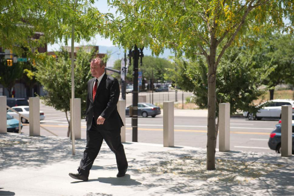 Rachel Molenda  |  The Salt Lake Tribune Indicted real estate developer and former UTA board chairman Terry Diehl enters the U.S. Courthouse in downtown Salt Lake City for his initial court appearance on Friday, June 30, 2017.