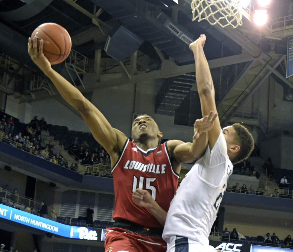 FILE - In this Jan. 24, 2017, file photo, Louisville guard Donovan Mitchell (45) goes up for a shot against Pittsburgh guard Cameron Johnson (23) during the second half of an NCAA college basketball game, in Pittsburgh. Mitchell left Louisville after his sophomore season and has the chance to be a lottery pick in Thursday's NBA draft. (AP Photo/Fred Vuich, FIle)